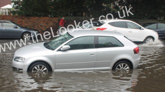 cars once again got stuck in flood water on the A259