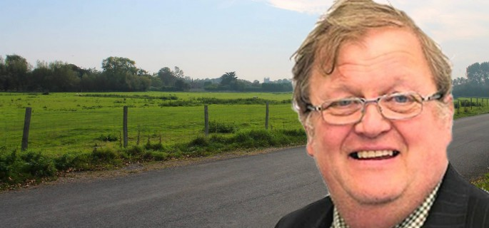 Cllr Simmons seen with one of the fields he wants to see 300 houses built on